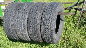 four 215/60/R17 studded winter tires