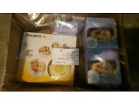 Medela swing electric breast pump, bags and breast pads