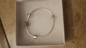 Pandora Bracelet with August birthstone Heart Gem and 2 Bumpers