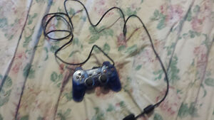 Two PS2 controllers with 3 PS2 games