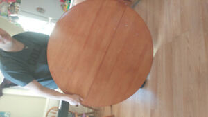 Round kitchen table. No chairs.