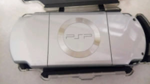 Sony PSP console, charger, case 4 movies, 5 games NO BATTERY