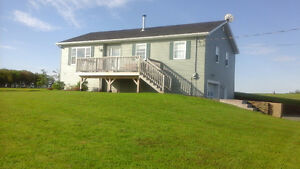 8 year old 3 bdrm bungalow on 3 acres with ocean view