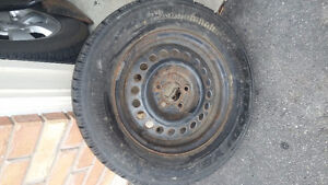 4 almost new  winter tires with rims