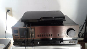 ps3 console with 1 ps4 game and 6 ps3 games and 2 controllers