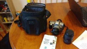 Minolta Camera with 2 lenses, and carry on bag.
