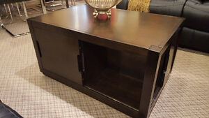 Modern wood coffee table with sliding doors on sale