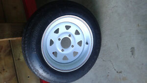 Trailer rim and tire 4-12-80