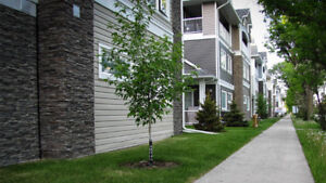 Executive Townhome Style Condo with Garage