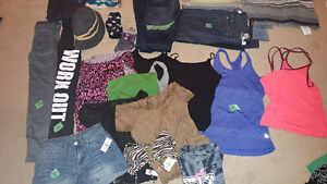 Lots of clothing and purses