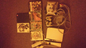 Nintendo Wii With 2 GC controllers 1 Wii controller and games