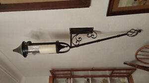 Wrought iron style candle holders.  Pair with glass covering.