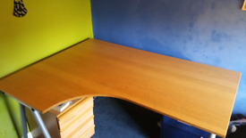 Large desk and wood draws.