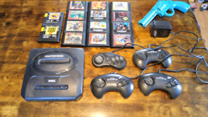Sega Genesis with 14 Games 4 controllers and a gun.