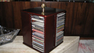Moving Sale:  Wood CD Organizer from Bombay-  holds 64 CDs