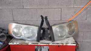 LEFT AND RIGHT HEADLIGHTS FOR A 02 DODGE RAM Windsor Region Ontario image 1