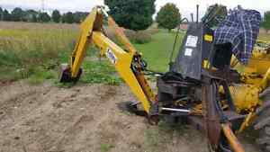 Kelley back hoe attachment