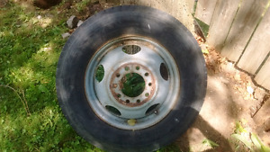 TRUCK TIRE AND RIM $50 8r 19.5