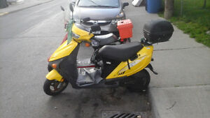 yellow scooter 50cc.