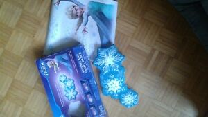 Frozen snowflake lights display with unused Elsa wall stickers