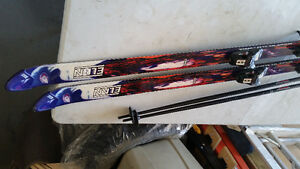 Assorted Skis/Boots/Poles for sale