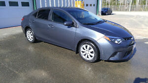 2015 Toyota Corolla (with extra set of winter tires)