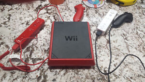 WII mini system with 19 games, 2 nunchuks and controllers