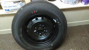 BRAND NEW TOYOTA RIM & TIRE - NEVER USED.