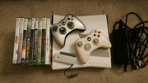 Xbox 360 + 2 Controllers + 9 Games (including Disney Infinity)*