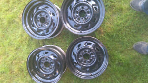2sets of Ford rims. 4 mags and 4 steel rims