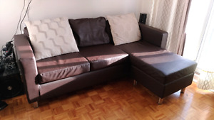 Sectional leather sofa with cushions