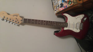 Squier guitar by fender candy red