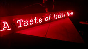 A taste of little italy neon sign