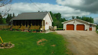Cozy bungalow on 2.98 acres of land with 2 garages!