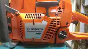 Brand new husqvarna  365 chainsaw ( 70CC)  not stihl but better
