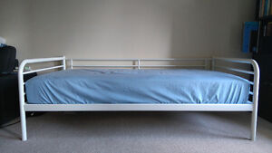 Twin size plush bed and a day bed frame