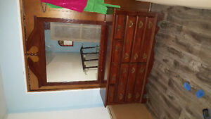 Dresser with mirror and headboard and bedside stand
