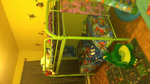 Bright green twin over twin bunk bed