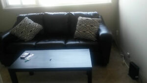 A big black sofa in real leather like new never used