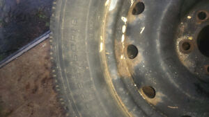 4 Goodyear Nordic Snow Tires w/ Rims attached