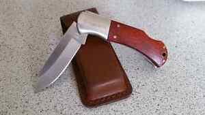 Knife and belt holster. Husqvarna