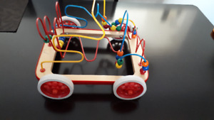 Wooden bead puzzles with wheels