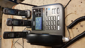 Uniden DECT 4096 2 line cordless phone with 3 handsets and base.