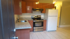 $2300+ utilities 3Br and 2Bath basement suite next to park