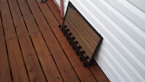 Black steel framed mirror with 9 tealight holders
