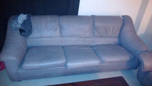 Leather couch grey in color