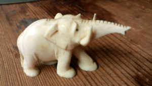 Ivory elephant one and a half inches high by 2 and 1/2 in Long
