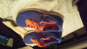 Blue and orange nikes