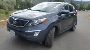 LOADED KIA SPORTAGE SX WITH TURBO AND AWD.