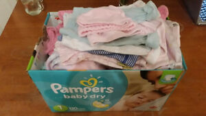 Box of girl baby clothes